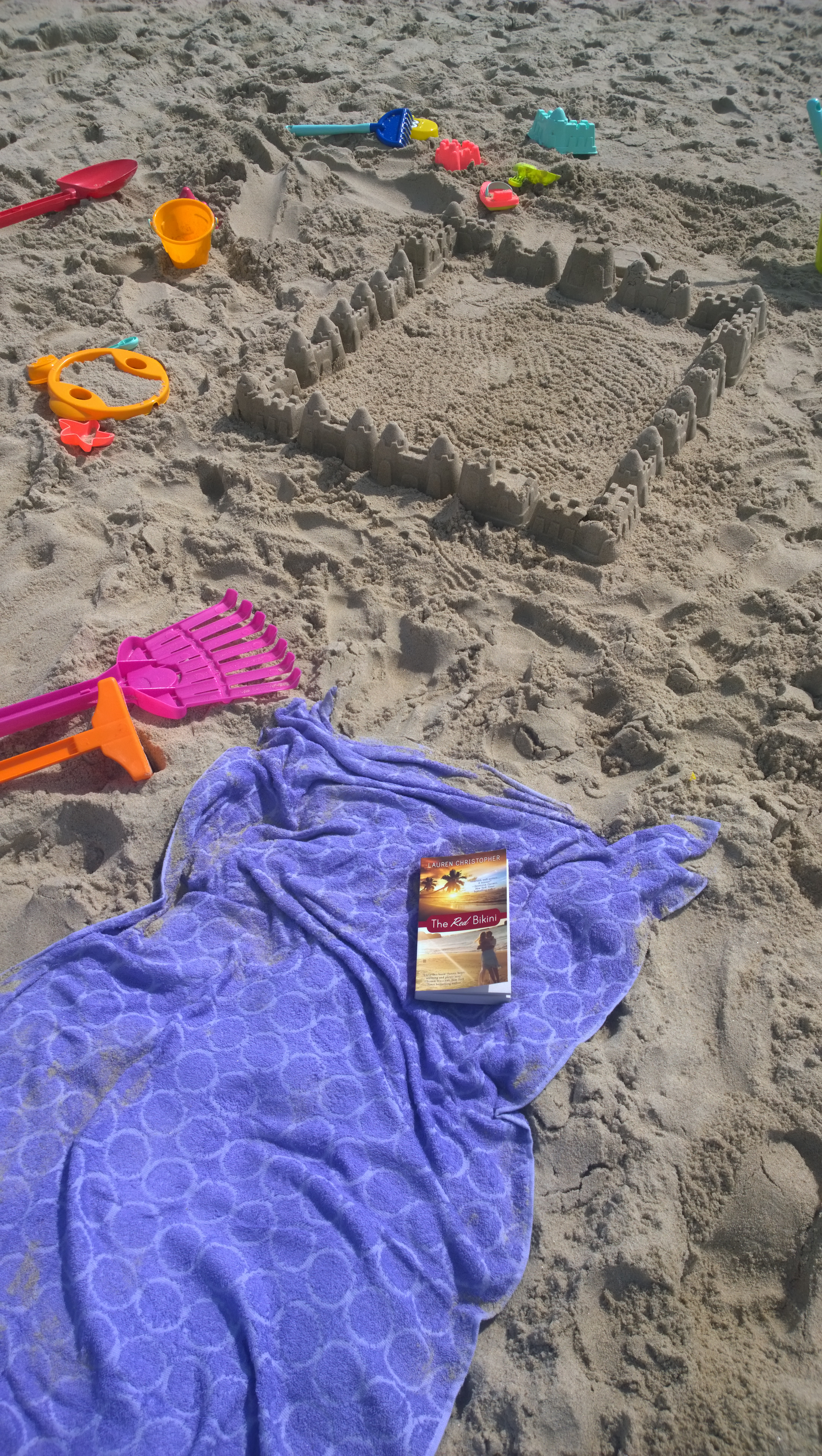 Debby B. With Her Kids At The Beach: She Reads While They Play!